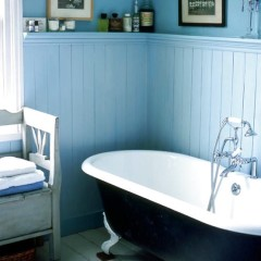 Victorian North London home: pale blue bathroom with tongue and groove wall panels; roll top bath. Pub Orig L etc 04/2004 p94