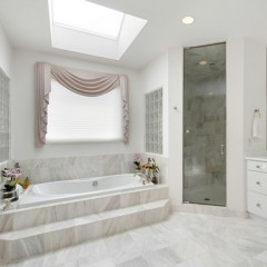 Master bath in luxury home with marble tub